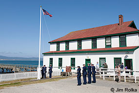 Coast Guard personnel raising the U.S. flag during the 2012 Memorial Day Ceremony at the Historic Lifeboat Station at Chimney Rock. © Jim Rolka.