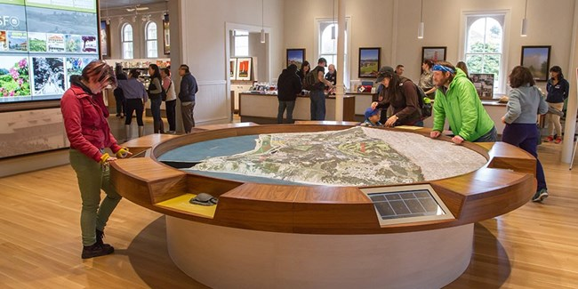 People looking at interpretive table.