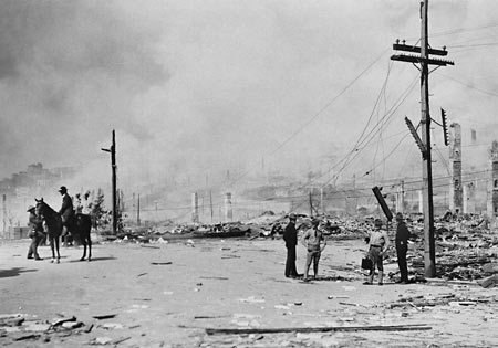 Signal Corps men repair lines after fire