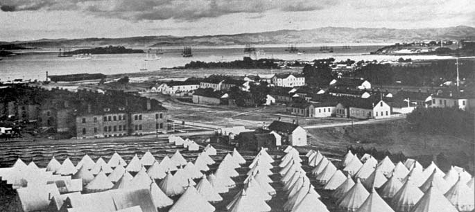 Photo of the Main Post area with tent camp in foreground and bay behind during the Spanish American War.