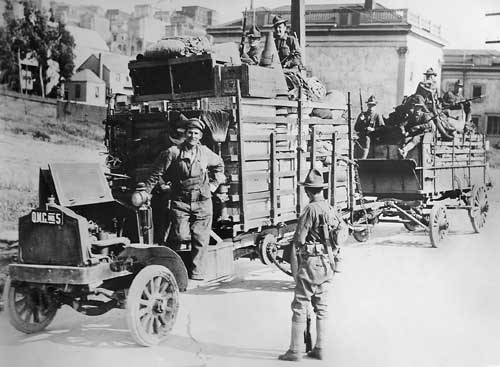 Quartermaster soldiers distributing relief supplies