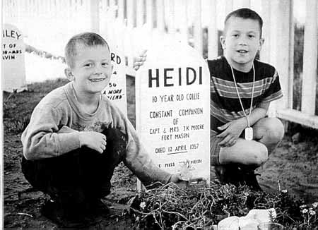 The sons of Capt. J. K. Moore pay tribute to their collie, Heidi, in 1957.