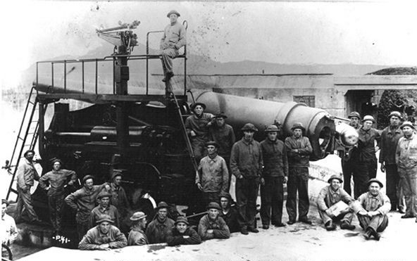 An artilley crew poses with a 10-inch gun at Battery Marcus Miller