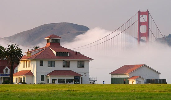 Fog entering the Golden Gate with Old Crissy Field Coast Guard Station in foreground
