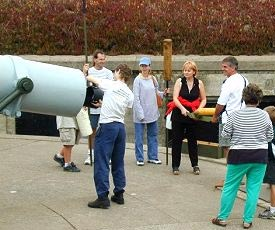 Docent leading loading demonstration of the gun