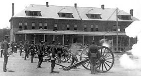 Firing field cannon in front of Infantry Row barracks, circa 1898.