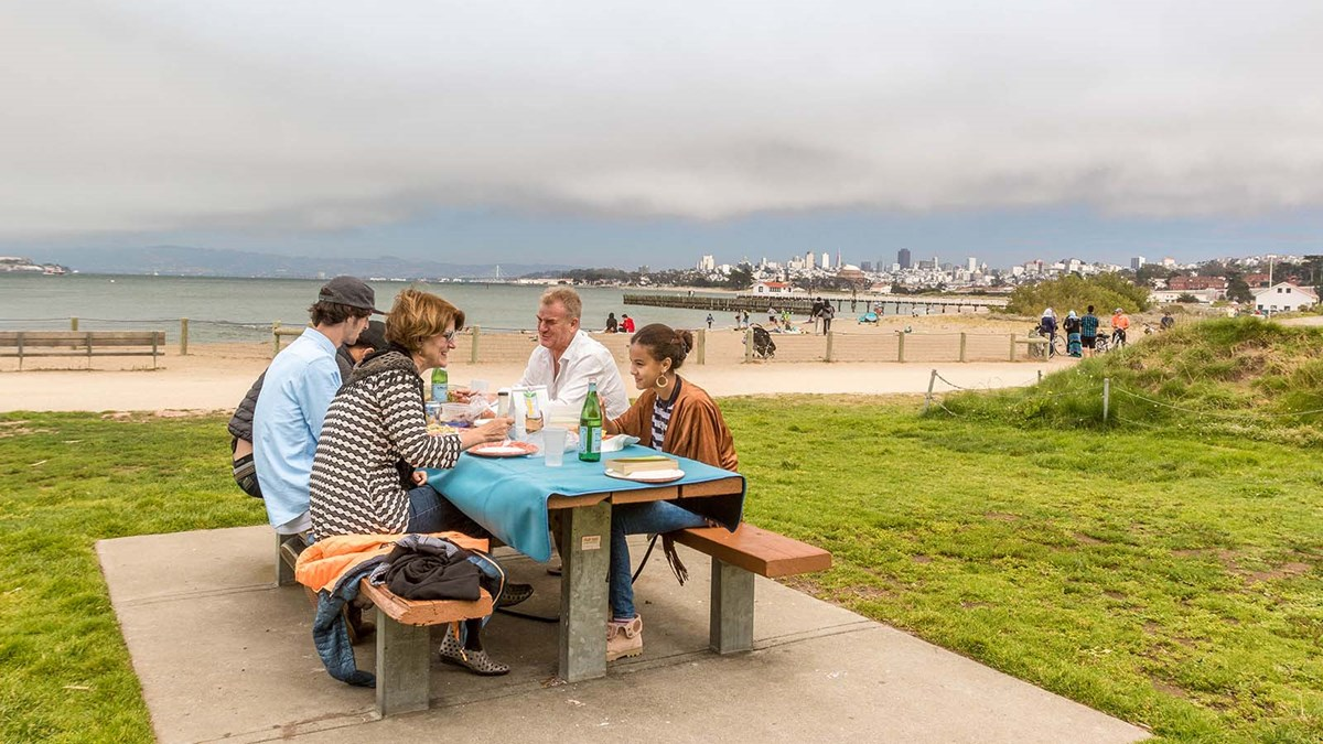 people eat on picnic table at crissy field
