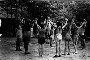 Children in a circle holding hands and playing games in Chopawamsic RDA in the 1930s.