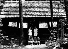 1930s cabin with campers