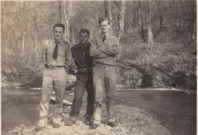 3 CCC members stand by river in the 1930s