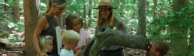Park Ranger talking to 5 kids and their parent
