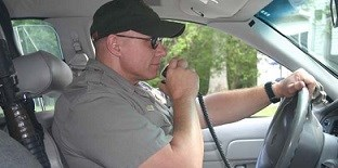 Law enforcement ranger in his vehicle