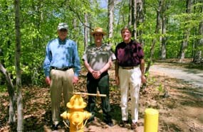 Regional Directors and Park Superintendent pose in front of new fire hydrant.