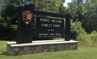 A wooden sign reading Prince William Forest Park. Established 1936. National Park Service.
