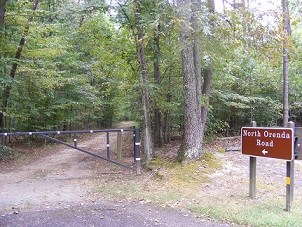 North Orenda Road trail sign and metal gate