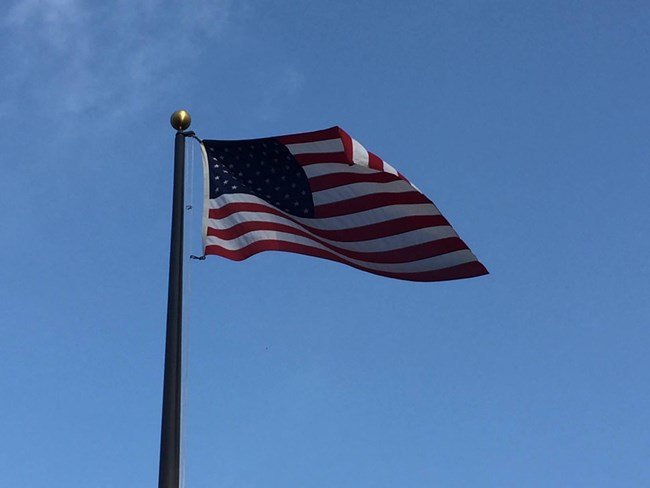 US flag flies in the breeze from a flagpole