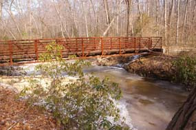 A bridge crossing over Quantico Creek leading to North Valley Trail and the old Cabin Branch Mine site.