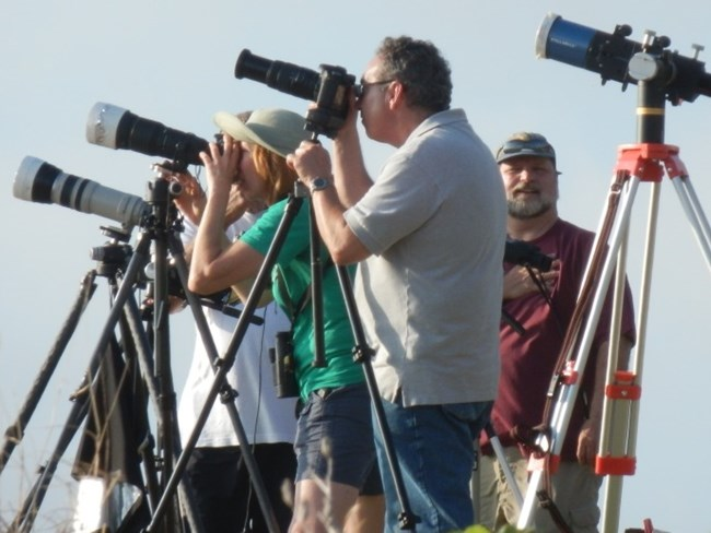 Photographers trying to capture Transit of Venus. (June 5, 2012)