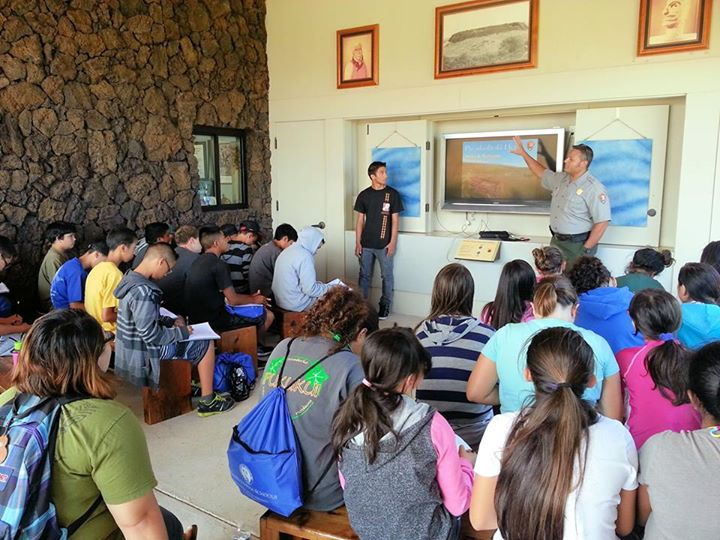 A park ranger gives a presentation to students.
