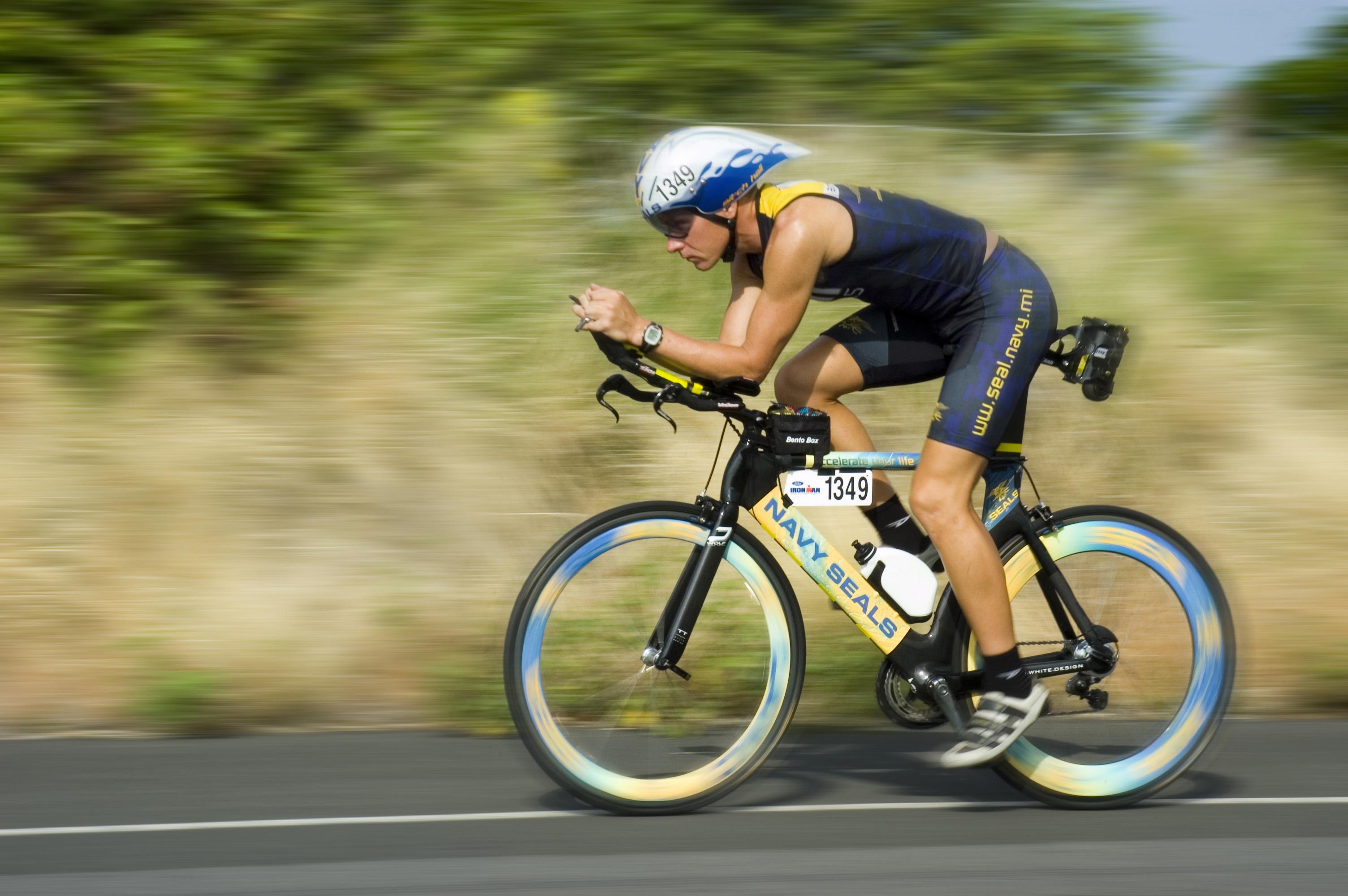U.S. Navy SEAL Mitch Hall, assigned to Naval Special Warfare Center, tests his racing bike in Kona, Hawaii one day prior to the Ironman Triathlon, Oct. 20, 2006. (DoD photo)