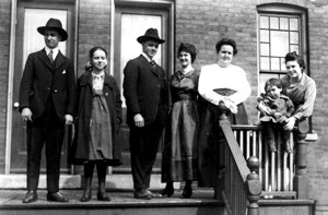 Seven Pullman Residents standing on a house porch.