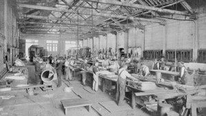 Workers in a Tin Shop Warehouse
