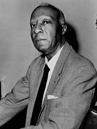 Black and White Photo of A. Philip Randolph wearing a suit and tie.