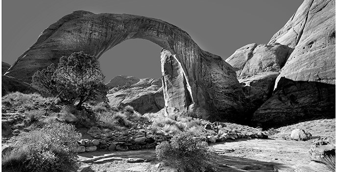 Black & white photo of Rainbow Bridge from the observation area.