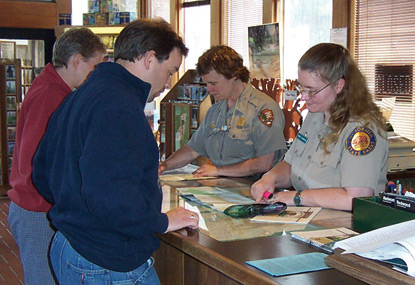 National Park Service and California State Parks staff with visitors at Crescent City Information Center.