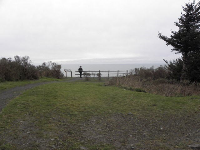 trail ends at railing which overlooks the Pacific Ocean