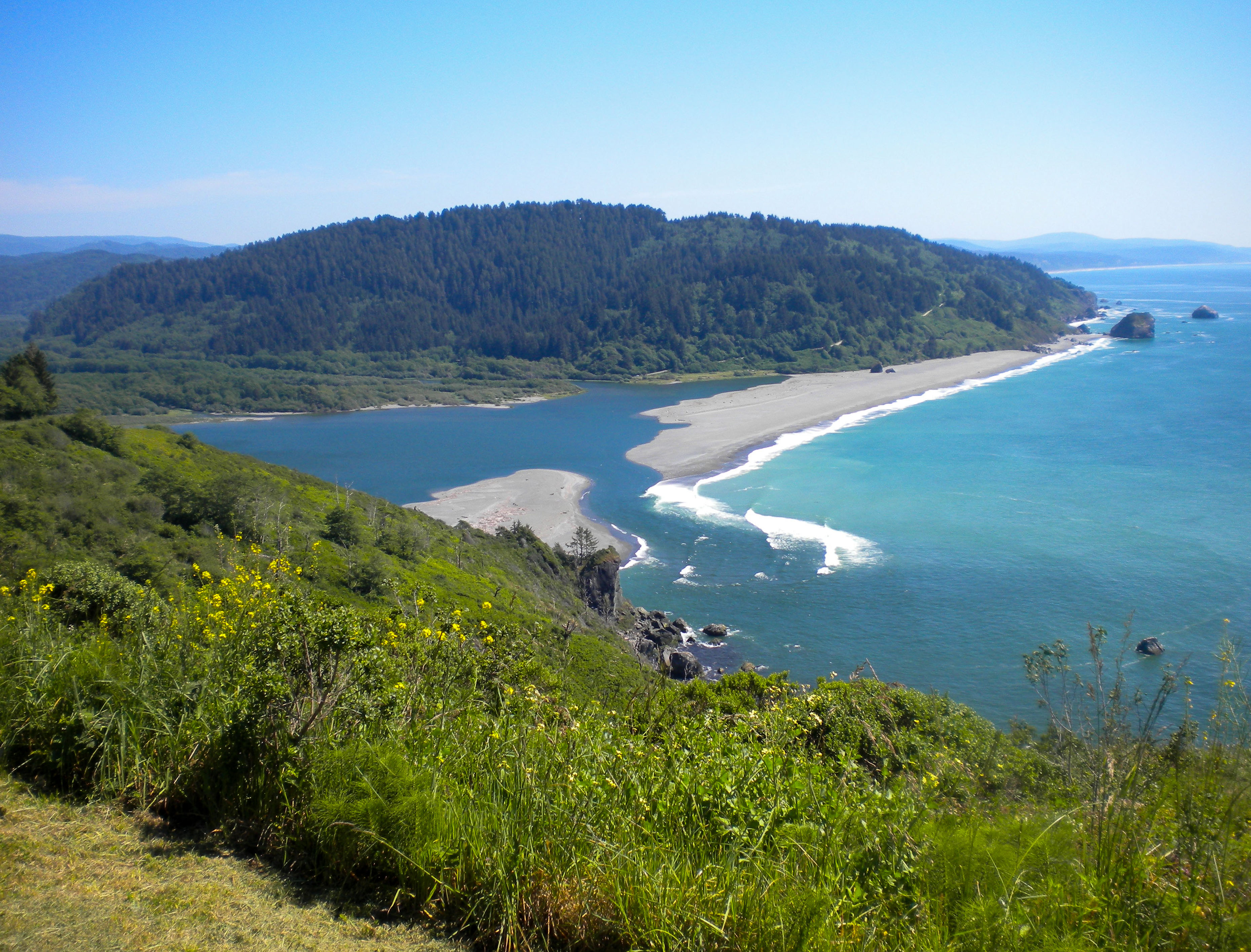 The mouth of the Klamath River where it meets the Pacific Ocean as seen from the Klamath River Overlook.