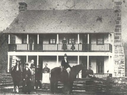 c. 1880s photo of the Cox family in front of the tavern