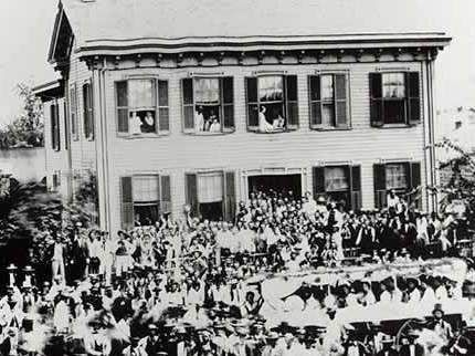 Photo of the Lincoln Home on August 8, 1860, during a presidental campaign rally for Lincoln.