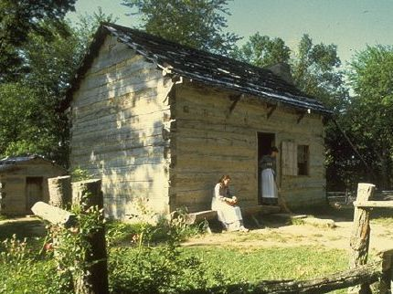 Reconstructed log cabins at living historical harm of Lincoln Boyhood Home National Memorial