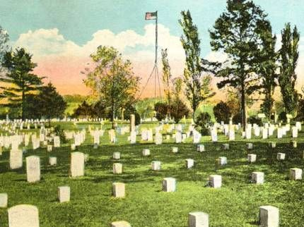 Photo of graves in Shiloh National Cemetery decorated with flags