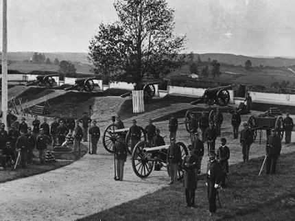 Photo of the officers and men of Company F, 3rd Massachusetts Heavy Artillery in Fort Stevens in 1865