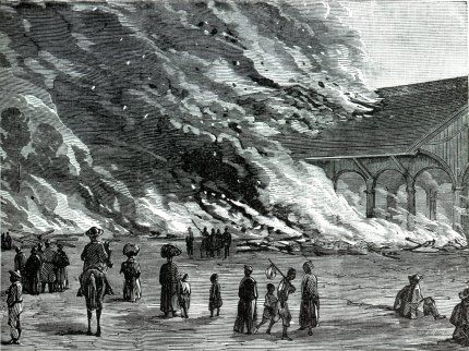 Woodcut of spectators watching a train station set fire by Sherman's troops
