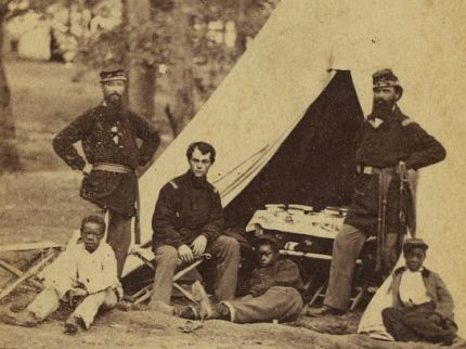 Photo of three African American boys in a Union army camp