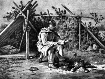 Engraving of soldier warming himself by a fire  Photo of U.S. Sanitary Commission office.