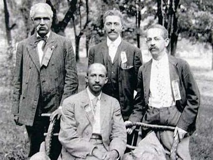 Photo of Niagara Movement members, including W.E.B. DuBois (seated), at Niagara Conference in Harpers Ferry