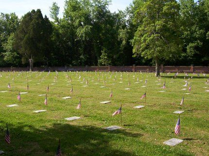 Photo of Poplar Grove National Cemetery, with flags decorating graves for Memorial Day