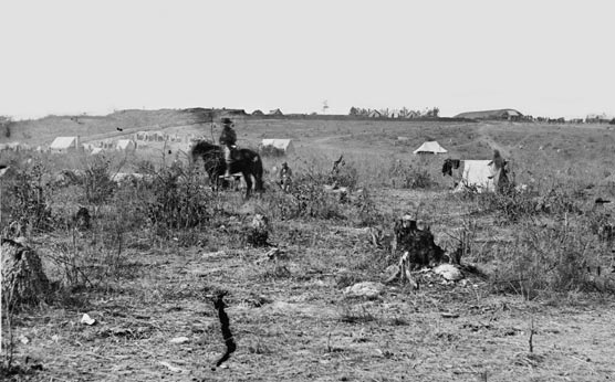 Civil War image.  Fort Harrison is in the distance, a man on horseback is in the foreground.