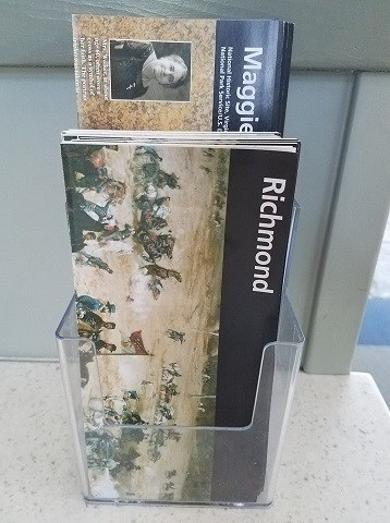 A standing rack displaying folded park maps.