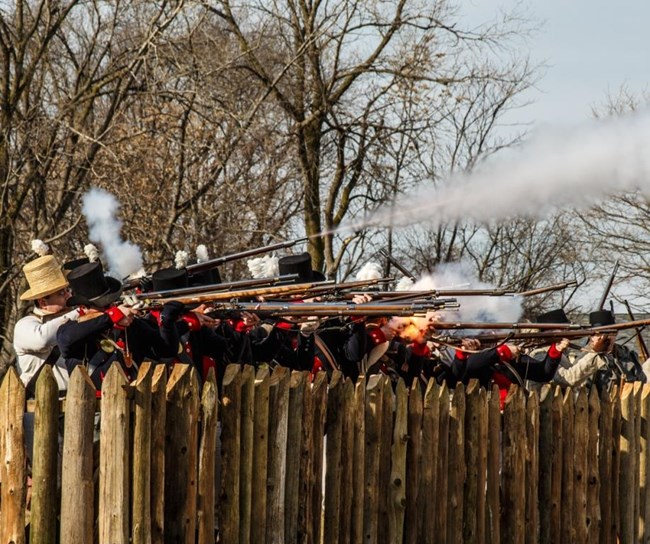 Soldiers firing behind the fences of Frenchtown
