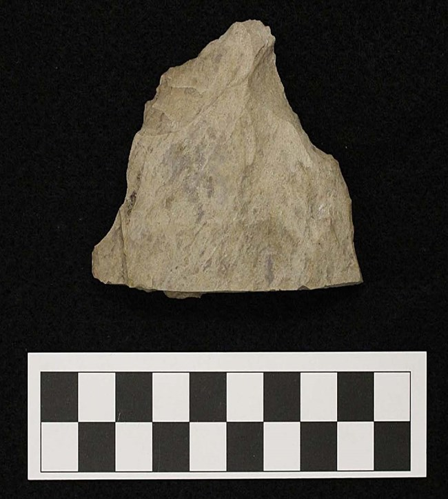 Stone tool made of grey quartzite