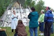 Interpreter speaks to visitors about Ojibwe cultural history.