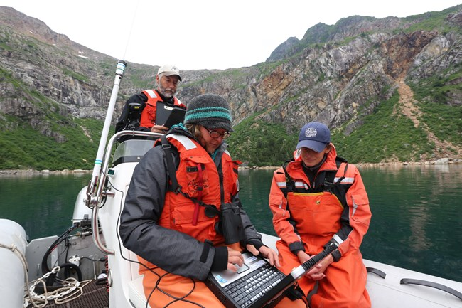 Researchers on skiff in Resurrection Bay