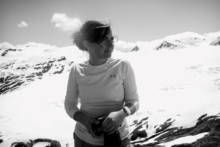 woman in front of glacier