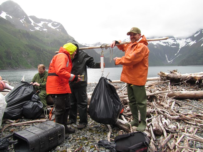 National Park staff weigh bags of trash collected from beach