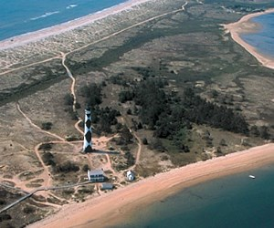 The Cape Lookout lighthouse sits close to the coast line on one of the barrier islands